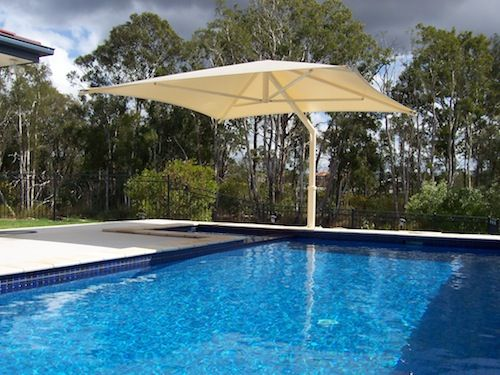 white swimming pool umbrella