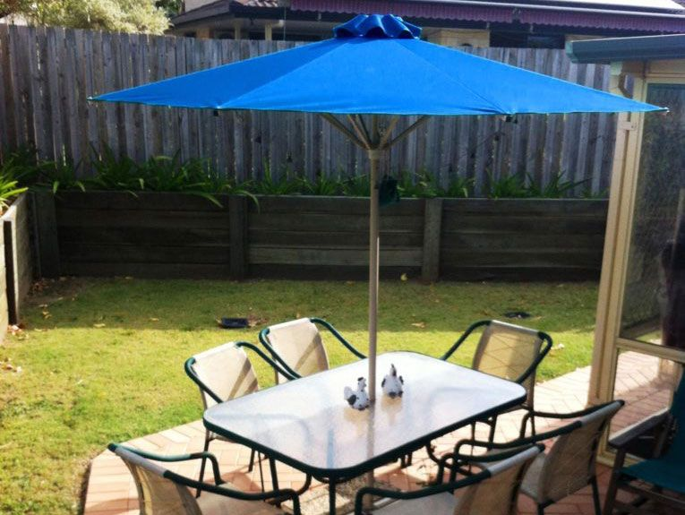 Blue Umbrellas with coffee table