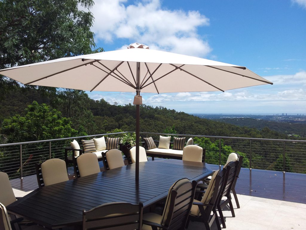 outdoor umbrellas with table and chairs