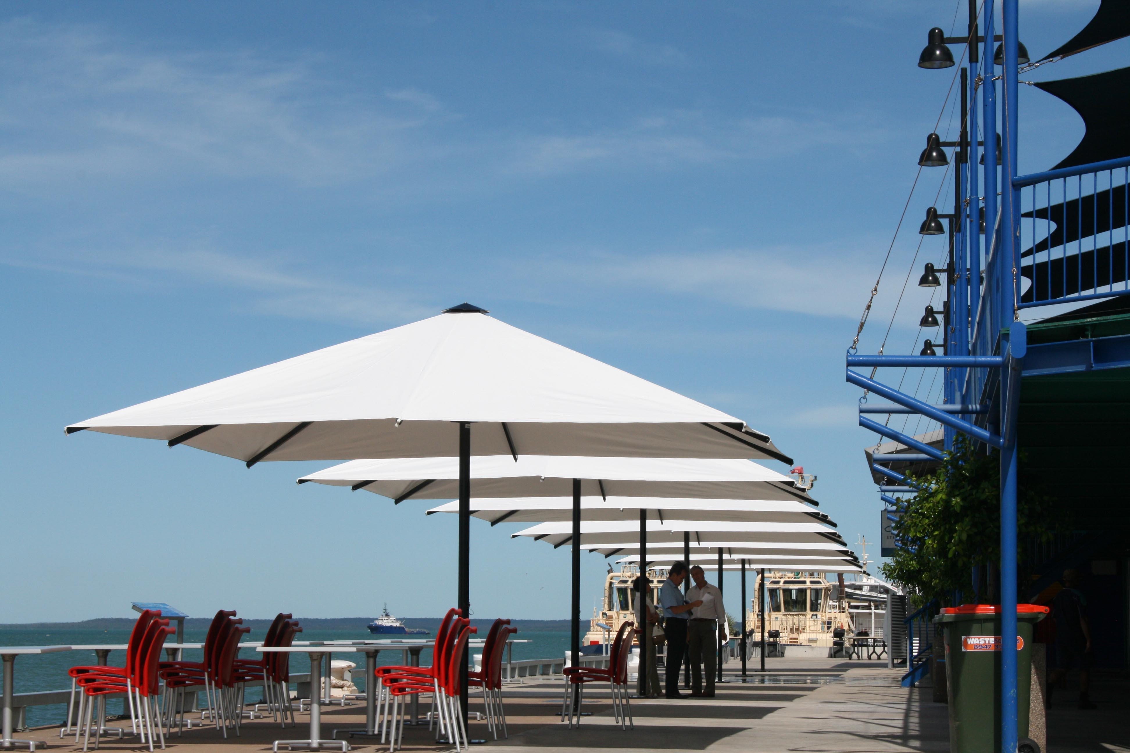 white outdoor beach umbrella
