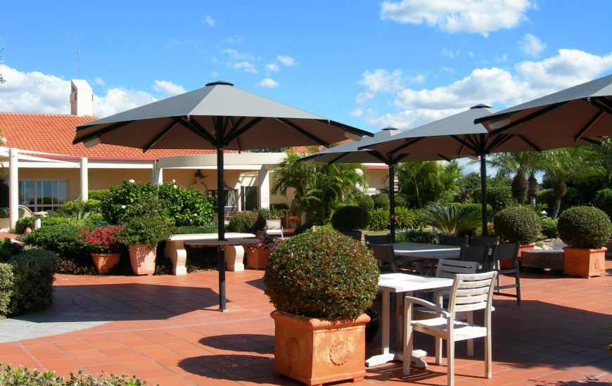 CE Heavy Duty Umbrella in courtyard