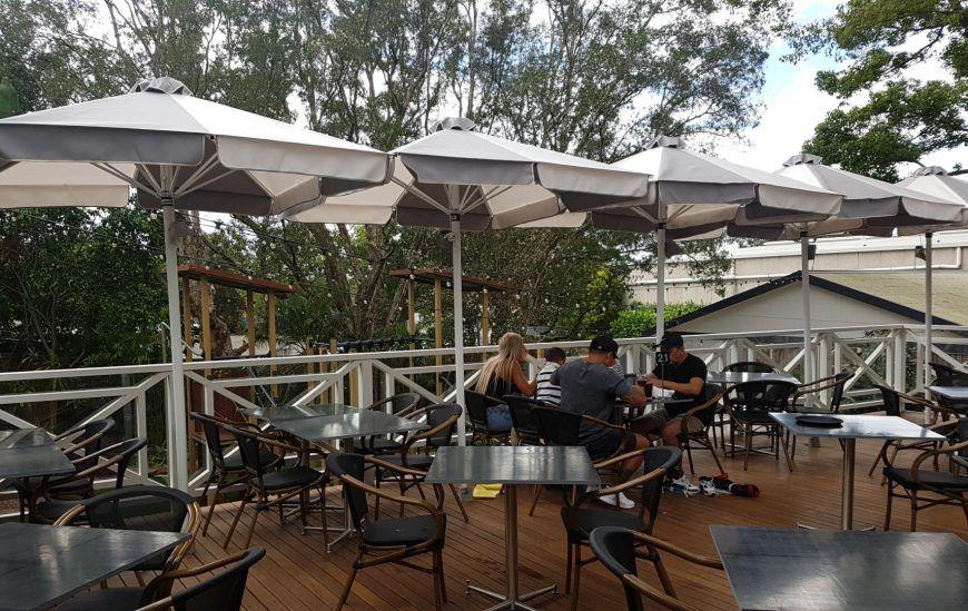 HE Cafe & Market Umbrella at a cafe
