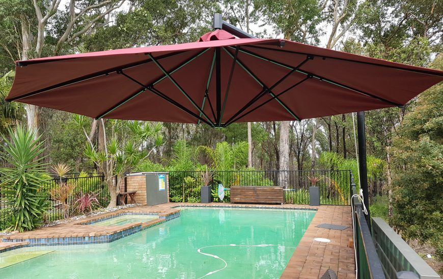 SP Side Post Umbrella by pool