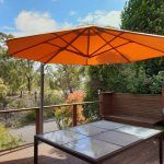octagon outdoor umbrella over table